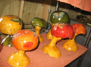 Gourd mushrooms treated with spar varnish for use as garden décor.